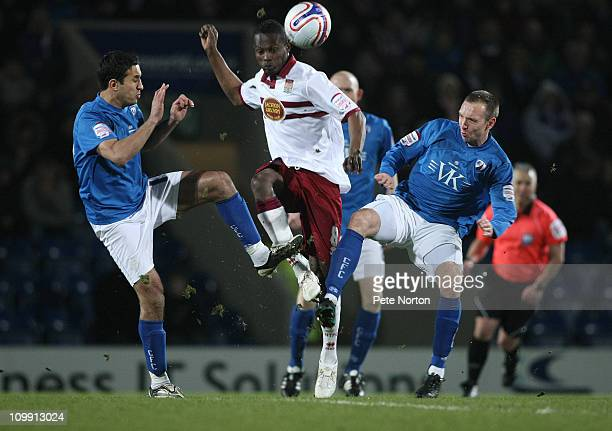Abdul Osman of Northampton Town challenges for the ball with Jack Lester and Mark Allott of Chesterfield during the npower League Two match between...