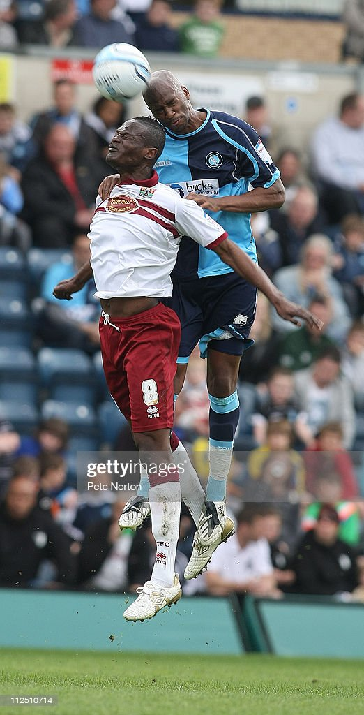 Abdul Osman of Northampton Town challenges for the ball with Leon Johnson of Wycombe Wanderers during the npower League Two League match between Wycombe Wanderers and Northampton Town at Adams Parks on April 16, 2011 in Wycombe, England.