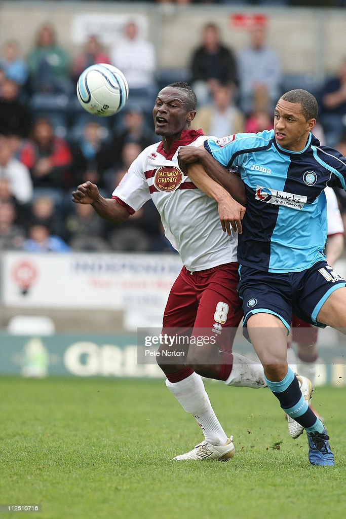Abdul Osman of Northampton Town challenges for the ball with Lewis Montrose of Wycombe Wanderers during the npower League Two League match between Wycombe Wanderers and Northampton Town at Adams Parks on April 16, 2011 in Wycombe, England.