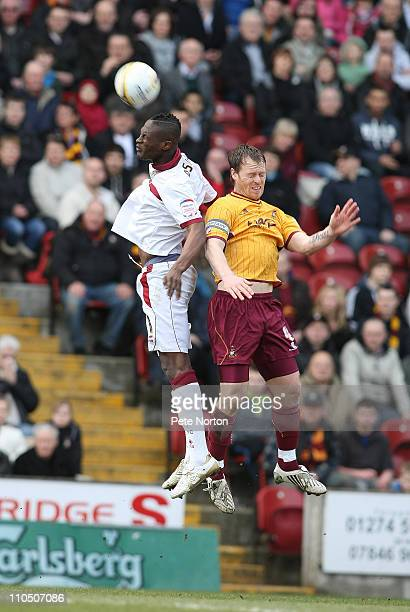 Abdul Osman of Northampton Town contests the ball with Michael Flynn of Bradford City during the npower League Two match between Bradford City and...