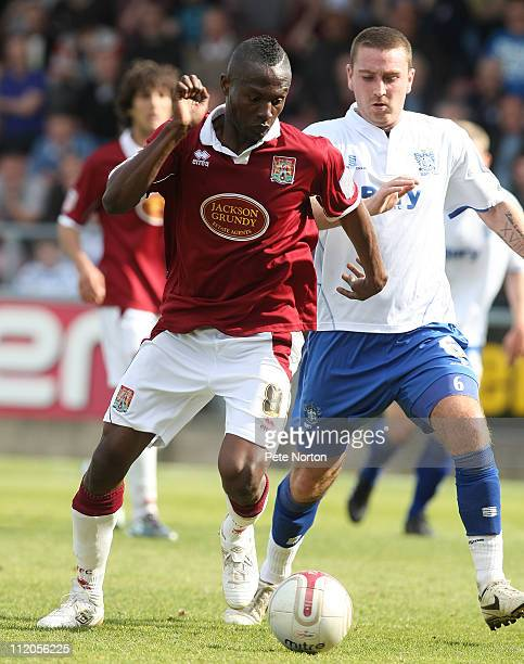Abdul Osman of Northampton Town controls the ball watched by Peter Sweeney of Bury during the npower League Two League match between Northampton Town...