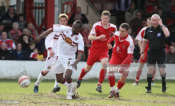 Abdul Osman of Northampton Town looks for the ball with Sean McConville of Accrington Stanley Luke Joyce of Accrington Stanley during the npower...