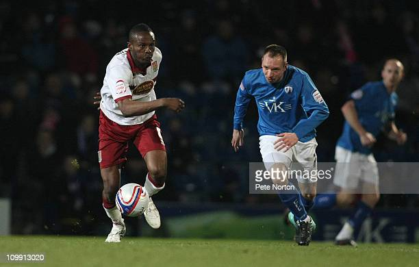 Abdul Osman of Northampton Town looks to move away with the ball watched by Mark Allott of Chesterfield during the npower League Two match between...