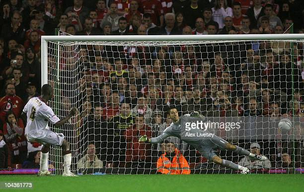 Abdul Osman of Northampton Town scores the winning penalty in a shootout past Brad Jones of Liverpool during the Carling Cup Third Round game between...
