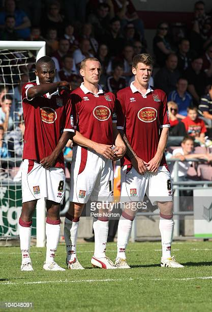 Abdul OsmanAndy Holt and Dean Beckwith of Northampton Town prepare to defend a free kick during the npower League Two match between Northampton Town...