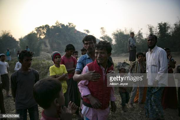 COX'S BAZAR BANGLADESH JANUARY 12 Abdul Rahim cries as the bodies of his wife and children are taken for burial in Balukhali camp on January 12 2018...