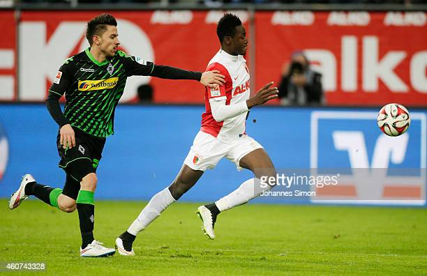 Abdul Rahman Baba of Augsburg competes for the ball with Julian Korb of Moenchengladbach during the Bundesliga match between FC Augsburg and Borussia...