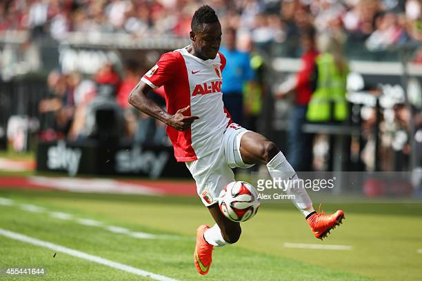 Abdul Rahman Baba of Augsburg controles the ball during the Bundesliga match between Eintracht Frankfurt and FC Augsburg at CommerzbankArena on...