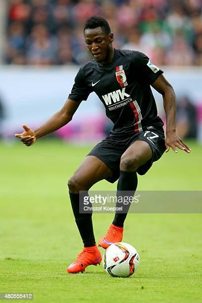Abdul Rahman Baba of Augsburg runs with the ball during the Telekom Cup 2015 Semi Final match between Borussia Moenchegladbach and Hamburger SV at...