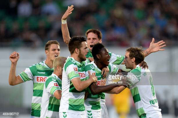 Abdul Rahman Baba of Fuerth celebrates with teammates after scoring the opening goal during the Bundesliga match between Greuther Fuerth and 1 FC...