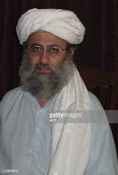 Abdul Rashid Ghazi a senior cleric at Islamabad's Lal Masjid sits at his desk June 21 2007 Ghazi has called for the installation of a hard line...