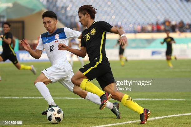 Abdul Rashid Muhanmmed Akhyar of Malaysia dribbles in action during the Men's Football Group E match between Kyrgyzstan and Malaysia at Si Jalak...