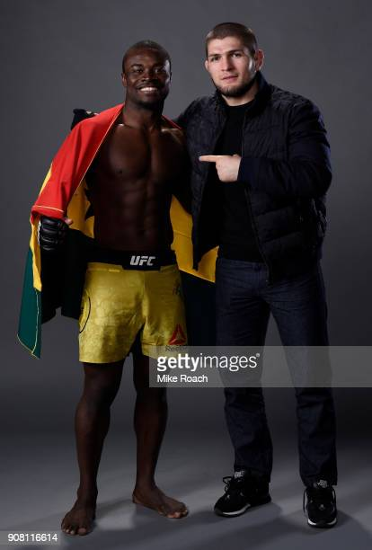 Abdul Razak Alhassan of Ghana poses for a portrait backstage with top lightweight Khabib Nurmagomedov after his victory over Sabah Homasi during the...