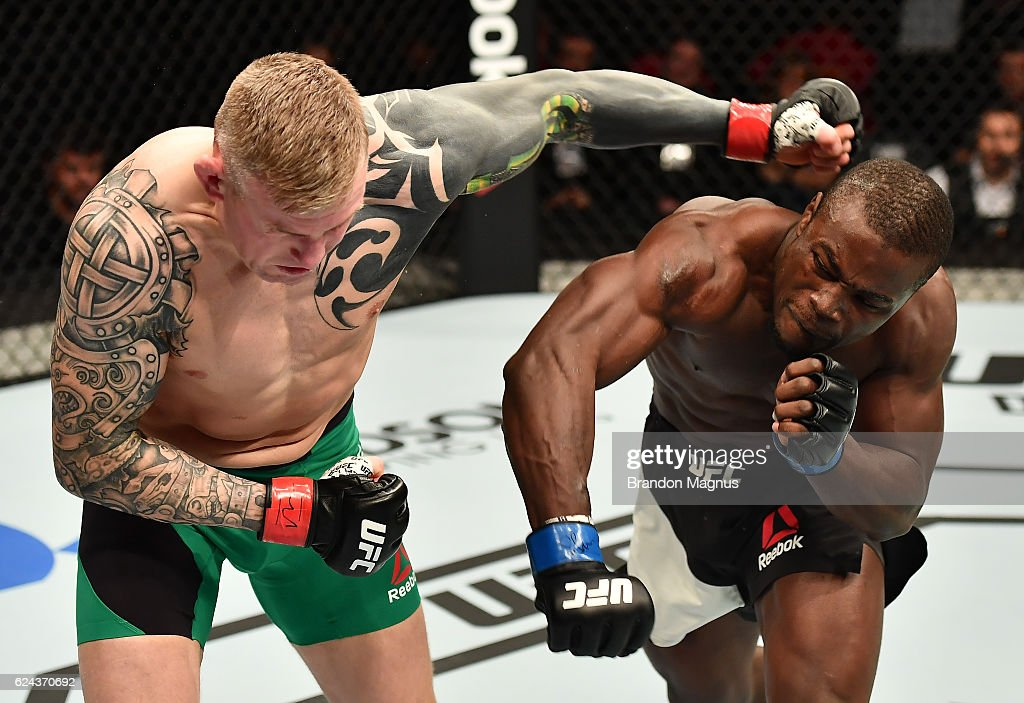 Abdul Razak Alhassan of Ghana punches Charlie Ward of Ireland in their welterweight bout during the UFC Fight Night at the SSE Arena on November 19, 2016 in Belfast, Northern Ireland.