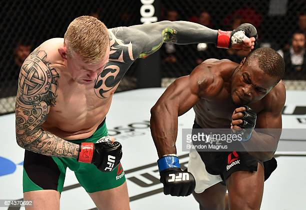 Abdul Razak Alhassan of Ghana punches Charlie Ward of Ireland in their welterweight bout during the UFC Fight Night at the SSE Arena on November 19...
