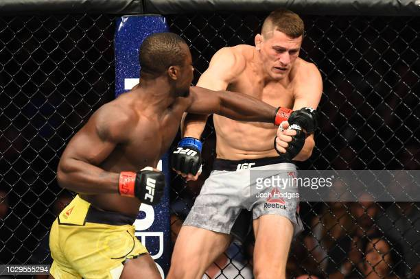 Abdul Razak Alhassan of Ghana punches Niko Price in their welterweight fight during the UFC 228 event at American Airlines Center on September 8 2018...