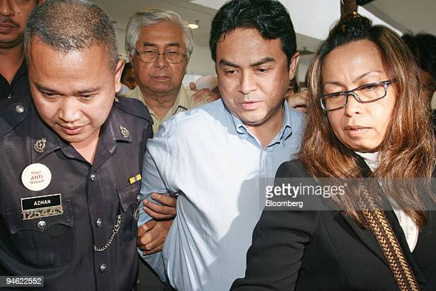 Abdul Razak Baginda executive director at Malaysian Strategic Research Centre center is led to lock up at Shah Alam Court in Selangor Malaysia on...
