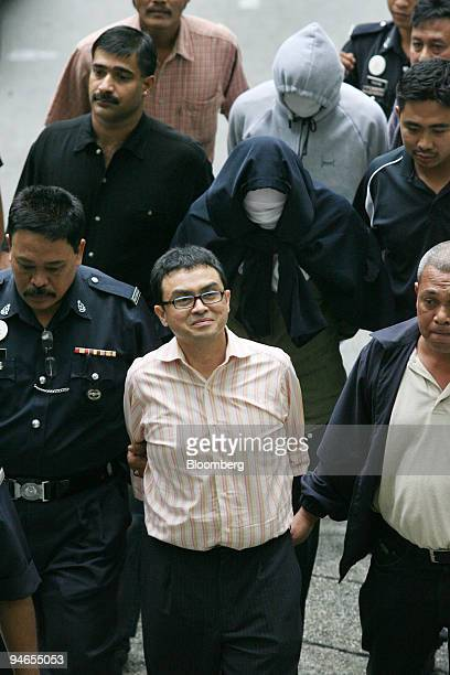 Abdul Razak Baginda is escorted by police on Friday Aug 3 in Kuala Lumpur Malaysia Baginda a political analyst who has worked for Malaysia Deputy...
