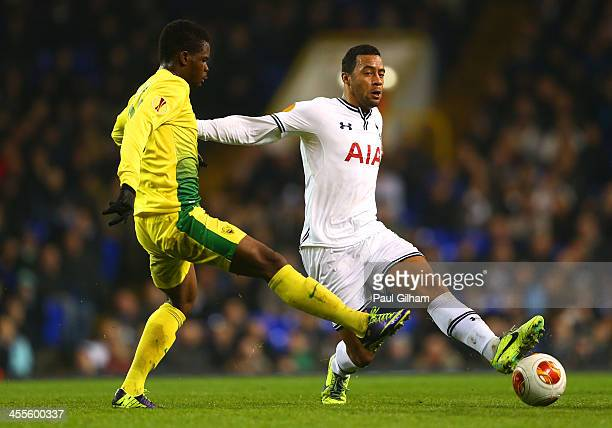 Abdul Razak of Anzhi Makhachkala tackles Mousa Dembele of Tottenham Hotspur during the UEFA Europa League Group K match between Tottenham Hotspur FC...