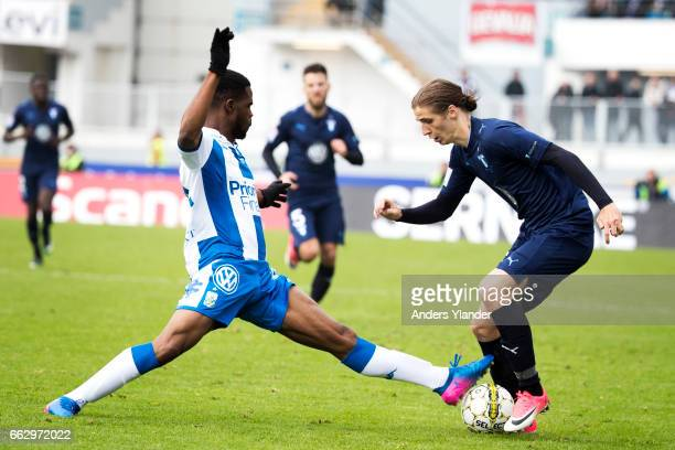 Abdul Razak of IFK Goteborg and Pavel Cibicki of Malmo FF competes for the ball during the Allsvenskan match between IFK Goteborg and Malmo FF at...