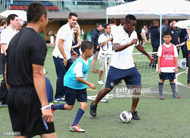Abdul Razak of Mancester City participates in a clinic with local children during the Barclays Asia Trophy Premier League Community Festival at on...