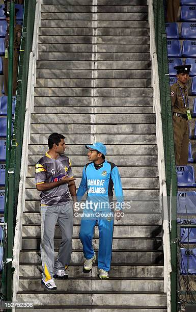 Abdul Razzak of Pakistan and Mushfiqur Rahim of Bangladesh chat while entering the arena ahead of the Group D match between Pakistan and Bangladesh...