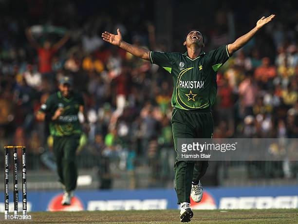 Abdul Razzaq of Pakistan celebrates the wicket of Mitchell Johnson of Australia during the 2011 ICC World Cup Group A match between Australia and...