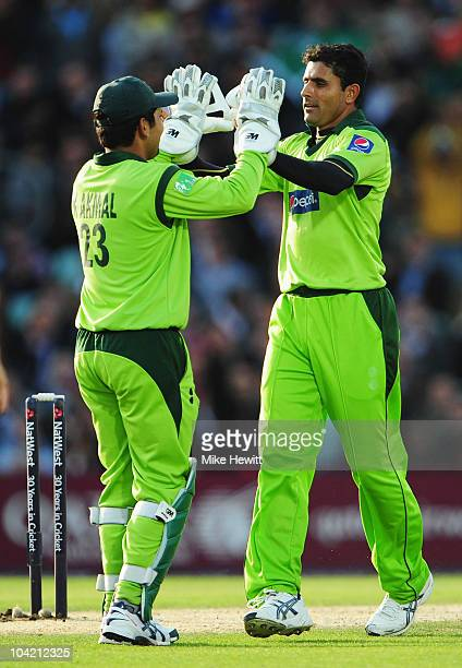 Abdul Razzaq of Pakistan celebrates the wicket of Steven Davies of England with Kamran Akmal during the 3rd NatWest One Day International between...