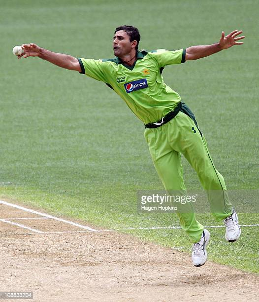 Abdul Razzaq of Pakistan fields the ball off his own bowling during game six of the one day series between New Zealand and Pakistan at Eden Park on...