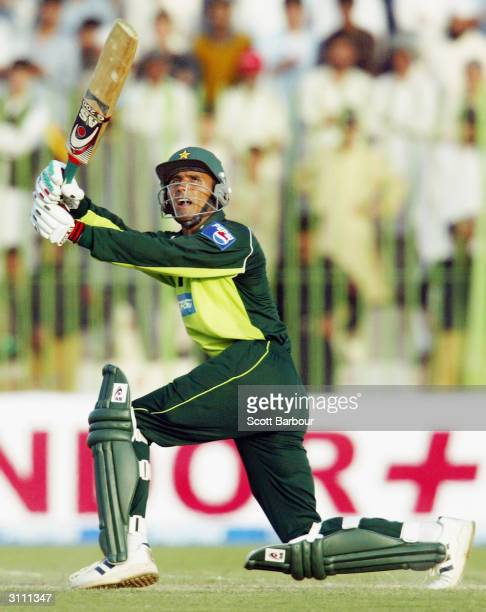 Abdul Razzaq of Pakistan hits a boundary during the third one day international match between Pakistan and India played at Arbab Niaz Stadium March...