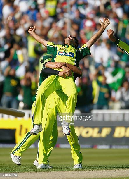 Abdul Razzaq of Pakistan is lefted up by teammates after taking the wicket of Paul Collingwood of England during the 5th NatWest Series One Day...