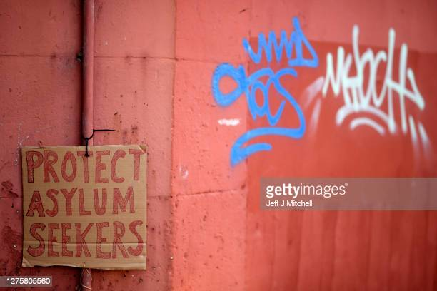 Abdul Safi, an Afghan asylum seeker hunger strikes outside the Home Office building on September 23, 2020 in Glasgow, Scotland. Mr Safi has stitched...