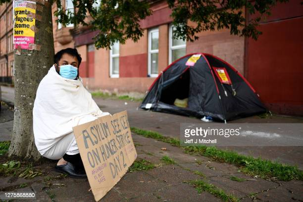 Abdul Safi an Afghan asylum seeker is joined by fellow Afghani's as he hunger strikes outside the Home Office building on September 23 2020 in...