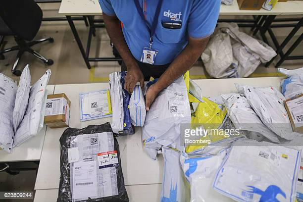 Abdul Saleem a deliveryman known as a Wishmaster for Flipkart Online Services Pvt's Ekart Logistics service sorts packages at the company's office in...