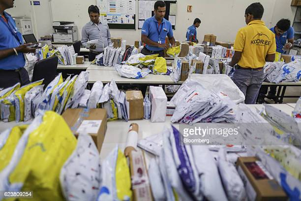 Abdul Saleem a deliveryman known as a Wishmaster for Flipkart Online Services Pvt's Ekart Logistics service center sorts packages at the company's...