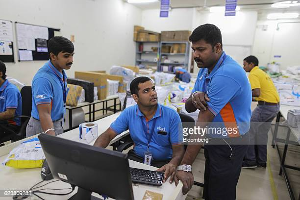 Abdul Saleem a deliveryman known as a Wishmaster for Flipkart Online Services Pvt's Ekart Logistics service center speaks with his colleagues at the...
