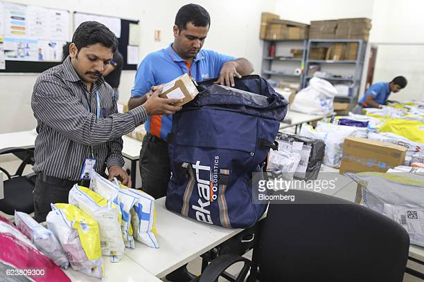 Abdul Saleem a deliveryman known as a Wishmaster for Flipkart Online Services Pvt's Ekart Logistics service center packs packages into his delivery...