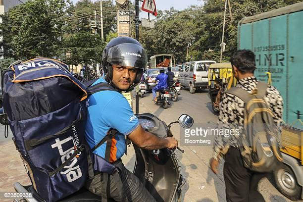 Abdul Saleem a deliveryman known as a Wishmaster for Flipkart Online Services Pvt's Ekart Logistics service left rides a motorcycle while delivering...