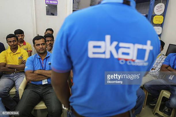 Abdul Saleem a deliveryman known as a Wishmaster for Flipkart Online Services Pvt's Ekart Logistics service front second left listens to a briefing...
