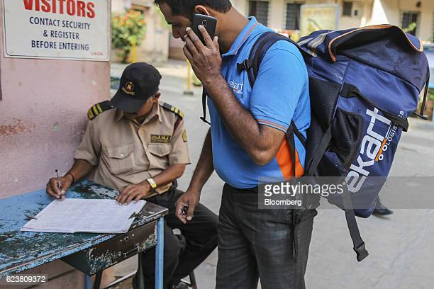 Abdul Saleem a deliveryman known as a Wishmaster for Flipkart Online Services Pvt's Ekart Logistics service uses a smartphone as he registers at a...