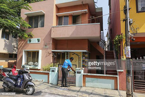 Abdul Saleem a deliveryman known as a Wishmaster for Flipkart Online Services Pvt's Ekart Logistics service delivers a package to a home in Bengaluru...