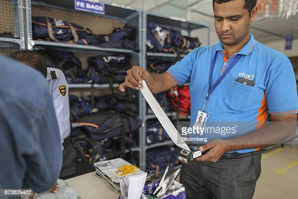 Abdul Saleem a deliveryman known as a Wishmaster for Flipkart Online Services Pvt's Ekart Logistics service holds a print out from a handheld point...