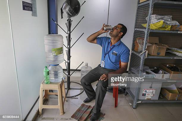 Abdul Saleem a deliveryman known as a Wishmaster for Flipkart Online Services Pvt's Ekart Logistics service drinks a cup of water after completing...