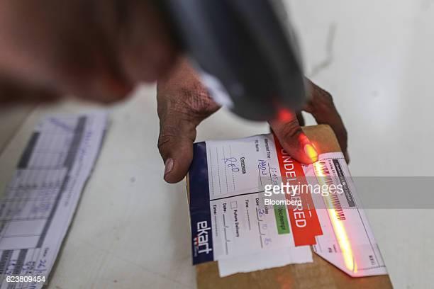 Abdul Saleem a deliveryman known as a Wishmaster for Flipkart Online Services Pvt's Ekart Logistics service scans the barcode of an undelivered...