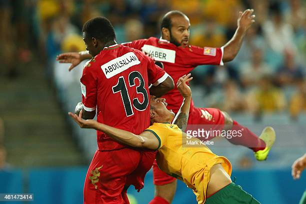 Abdul Sallam Al Mukhani of Oman fouls Tim Cahill of Australia leading to a penalty during the 2015 Asian Cup match between Oman and Australia at ANZ...
