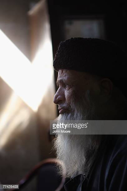 Abdul Sattar Edhi founder of the Edhi Foundation awaits new arrivals to his morgue October 20 2007 in Karachi Pakistan The Edhi foundation received...
