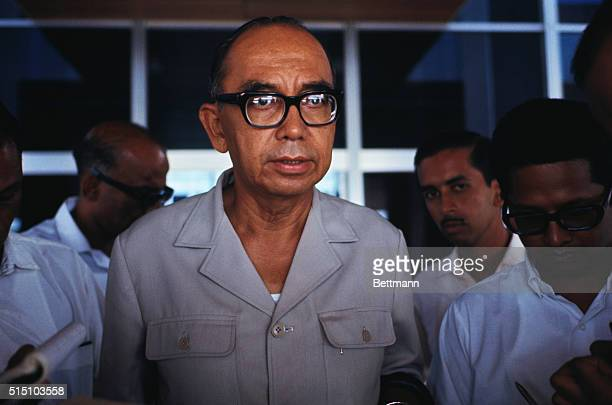 Abdul Trazak, the Prime Minister is shown in this closeup photo wearing glasses and a khaki shirt.