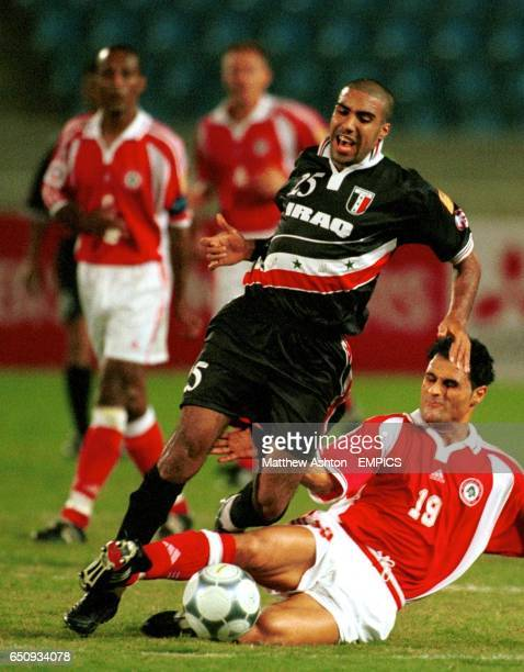 Abdul Wahab of Iraq is tackled by Lebanon's Mouhamad Al Reda
