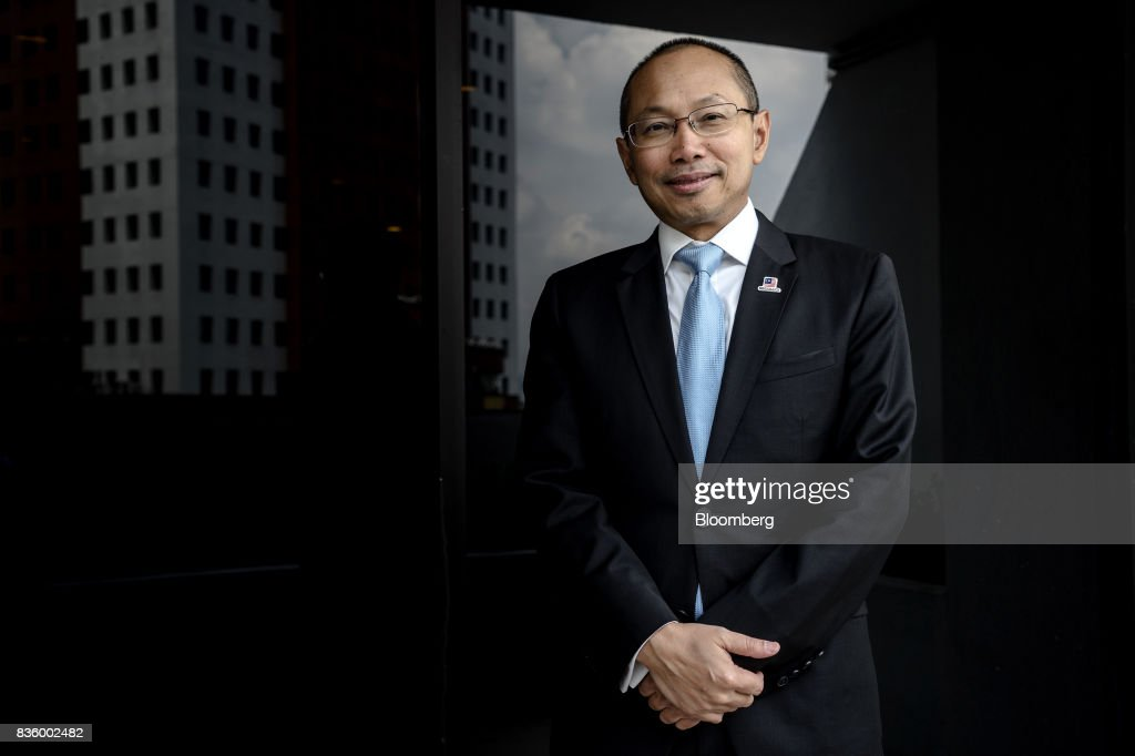 Abdul Wahid Omar, chairman of Permodalan National Bhd., poses for a photograph in Kuala Lumpur, Malaysia, on Thursday, Aug. 17, 2017. Malaysia's largest state-owned fund manager is looking to hold less cash even as it struggles to make acquisitions that would generate attractive returns. Photographer: Sanjit Das/Bloomberg via Getty Images