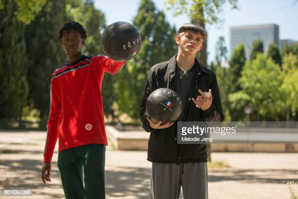 Abdulaye Niang Jose Luis Lucero hold basketballs outside the Lanvin show on June 25 2017 in Paris France
